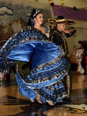Dancers spend weeks preparing to perform in Hondo's annual fiesta. Each costume is made by hand in the community.