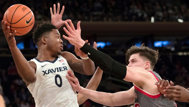 Xavier forward Tyrique Jones (0) looks to pass the ball around St. John's forward Amar Alibegovic (10) during the first half a game in the quarterfinals of the Big East conference tournament, Thursday, March 8, 2018, at Madison Square Garden in New York.