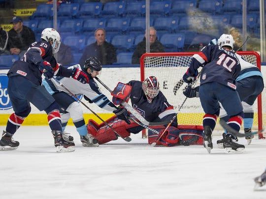 Goaltender Drew DeRidder (1) makes a stop Friday night, during the U.S. NTDP Under-18 team's 6-4 win over Madison.