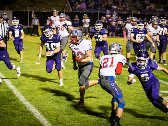 Senior running back Ty Snelson breaks through a big hole opened up by the Madison offense line on his way to a 23-yard touchdown run.