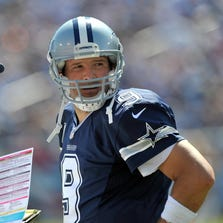 Sep 14, 2014; Nashville, TN, USA; Dallas Cowboys passing game coordinator Scott Linehan talks with Dallas quarterback Tony Romo (9) on the sideline during the second half Tennessee Titans at LP Field. Dallas won 26-10. Mandatory Credit: Jim Brown-USA TODAY Sports