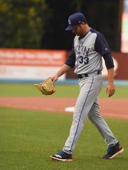 Matt Harvey of the New York Mets walks off the field