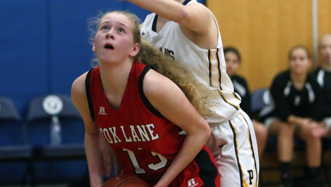 Fox Lane's Katy Mitchell prepares to go up for a shot at Pelham Memorial High School on Jan. 28, 2017.