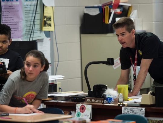 Ryan Harris leads a math game with his fifth grade