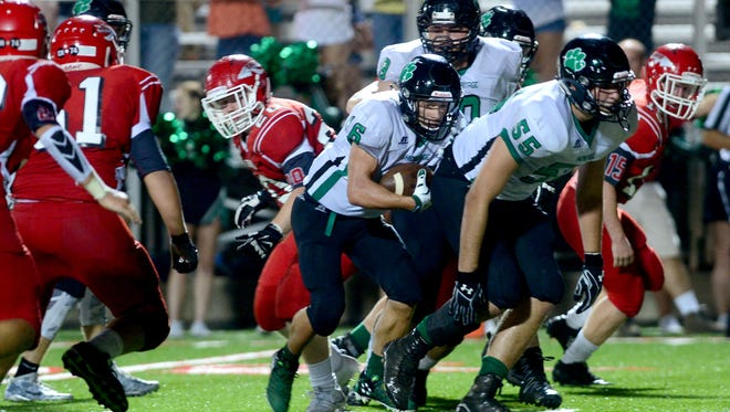 Mountain Heritage Justin Keener (16) rushed for six touchdowns Friday night. The Cougars won at Erwin, 58-31.