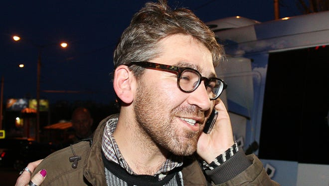 U.S. journalist Simon Ostrovsky, who was abducted and held by pro-Kremlin rebels in east Ukraine, speaks on a mobile phone fter his release April 24, 2014.