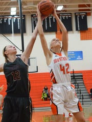 Northville's Brook Adams (right) battles Dexter's Shelbea