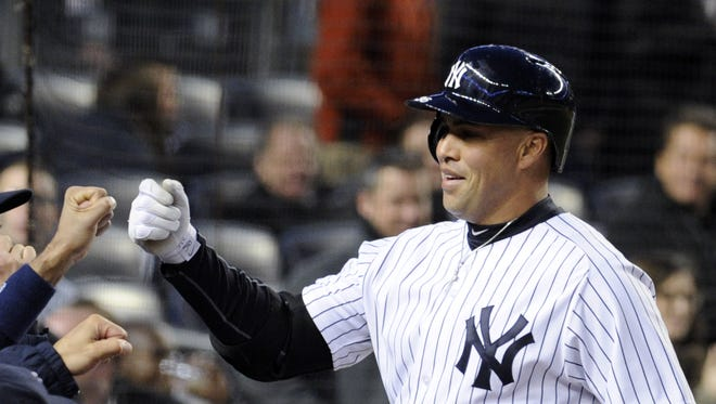 The Yankees' Carlos Beltran celebrates as he returns to the dugout after hitting a home run during the second inning of Wednesday night's game against the Baltimore Orioles.