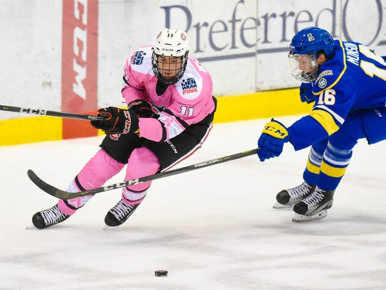 St. Cloud State's Ryan Poehling (11) passes the puck around Alaska's Tayler Munson on Oct. 14 at the Herb Brooks National Hockey Center. Poehling was named to USA Hockey's preliminary roster for the IIHF World Junior Championships that will be played Dec. 26-Jan. 5 in Buffalo, New York.