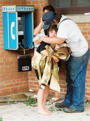 Jeff Smith hugs his daughter Katie Wieting, as mother