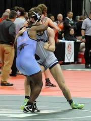Granville's Mathieu Holt wrestles Alliance Duce Johnson