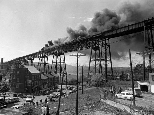 Above: A 1974 fire damaged the Poughkeepsie Railroad Bridge.