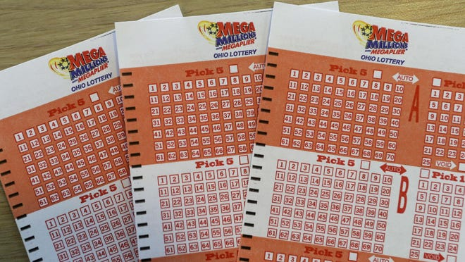 Mega Millions bet cards are shown at the Corner Market, Wednesday, Oct. 17, 2018, in Lyndhurst, Ohio.