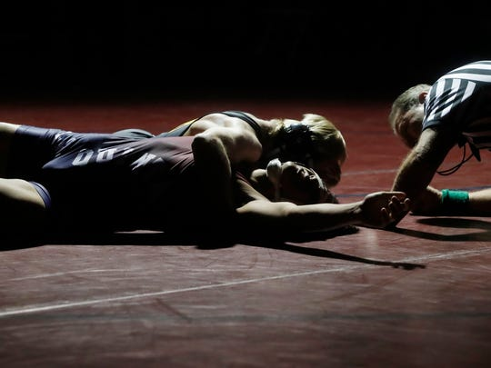 La Quinta High School's Ben Velasco tries to avoid the pin from Palm Desert High School's Michael Cochran in the 145 pound boys weight class at La Quinta High School on January 10, 2018.
