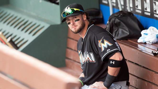 Miami Marlins catcher Jarrod Saltalamacchia (39) sits in the dugout before a game against the Philadelphia Phillies at Citizens Bank Park.