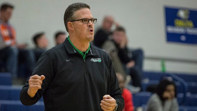 Yorktown's Greg Miller coaches the boys basketball team in the Delaware County Tournament this year. After six seasons of coaching the Tigers, Miller is stepping down.