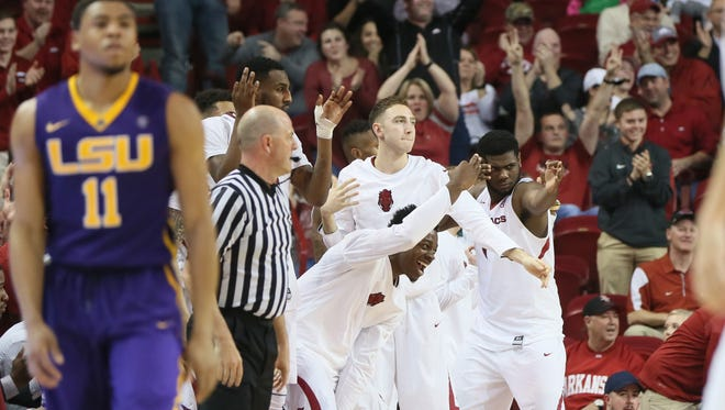 LSU Tigers guard Jalyn Patterson (11) looks on as Arkansas players celebrate their win over the Tigers.