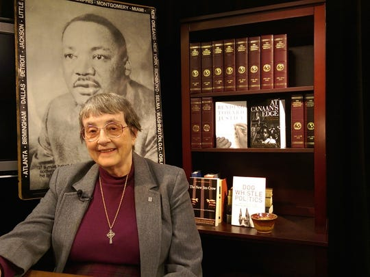 Rev. Janet Wolfe on set at Marshfield Community Television Studios in 2015 with personal memorabilia from her involvement in the Civil Rights Movement.