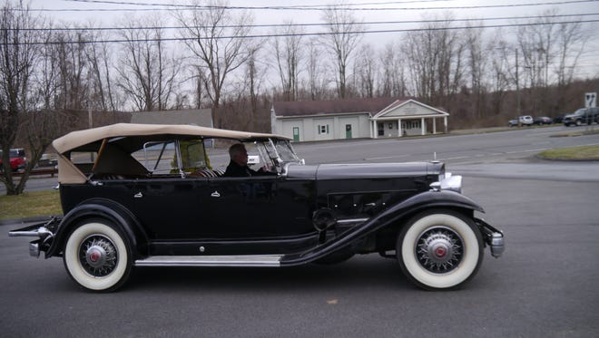 Wayne Carini of F40 Motorsports drives a 1932 Packard used by Franklin Delano Roosevelt. The car, which Gov. Andrew Cuomo's administration spent $10,440 to fix up, was featured on an episode of Chasing Classic Cars on the Velocity network.