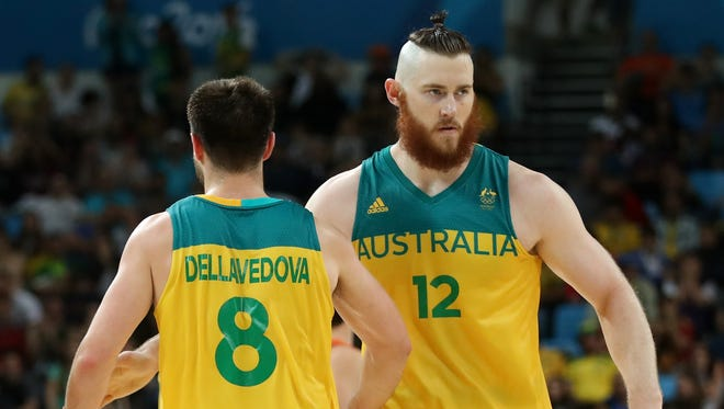 Aron Baynes #12 of Australia celebrates with Matthew Dellavedova #8 of Australia during the Men's Basketball Bronze medal game between Australia and Spain on Day 16 of the Rio 2016 Olympic Games at Carioca Arena 1 on August 21, 2016 in Rio de Janeiro, Brazil.