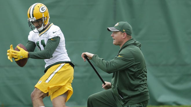 Green Bay Packers receiver Trevor Davis (11) works with wide receivers coach Luke Getsy during organized team activities Tuesday, May 23, 2017 in Green Bay.