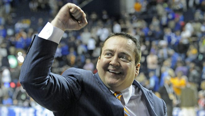 Tennessee coach Donnie Tyndall pumps his fist after the Vols beat Vanderbilt 67-61 in the SEC Tournament at Bridgestone Arena on Thursday.