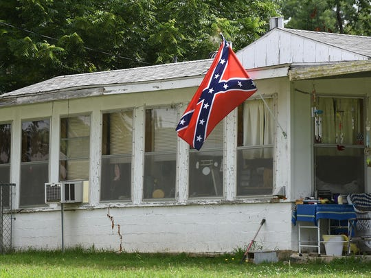 A Confederate flag flies at a house in Bull Shoals on Monday. Controversy surrounding the flag has sparked discussion across the nation.