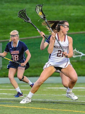 Morristown senior Annika Begley (21) looks towards the goal past Mountain Lakes' Erin O'Neil (19) during the Morris County Tournament final in Montville, May 5, 2018.