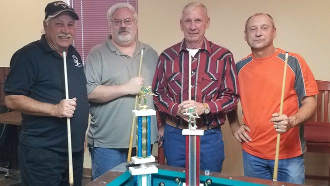"""First and second place winner of the friendship pool for November are (L-R) Larry """"Smitty"""" Smith, Doug Beard, John Andre and John Pietrzak."""