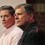 "Louisville athletic director Tom Jurich, right, talks as Mark Jurich, senior associate athletic director for development, listens at left. The University of Louisville plans to expand Papa John's Cardinal Stadium to 65,000 seats. About 10,000 seats will be added with the expansion, including 1,000 club seats and 65 ""premium"" loge level seats as well as 10 field level suites. The design will connect the east and west sides of the stadium. Athletic Director Tom Jurich says he plans to have the expansion completed in the next two years, though no completion date has been set. The project cost is an estimated $55 million, raised through sponsorships, private donations and ticket sales. Aug. 27, 2015"