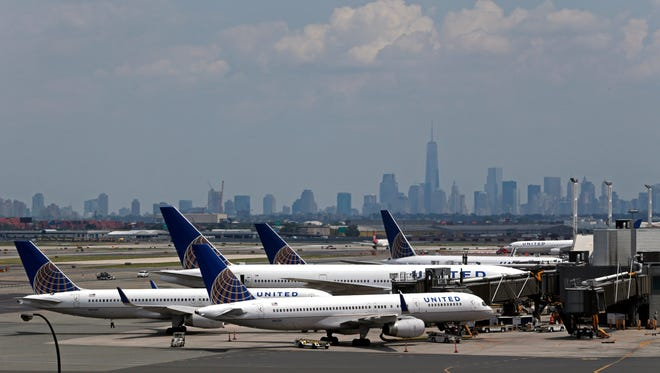 This file photo from July 22, 2014, shows United Airlines jets at Newark Liberty International Airport.