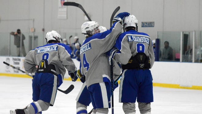 Salem's Sean McCormack (8), Joey Driscoll (4) and Matt Schaumburger (9) celebrate after a goal during the MIHL Showcase in Trenton.