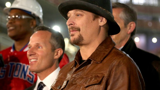 Kid Rock poses for a group picture with other dignitaries and construction workers after a press conference was held inside the Little Caesars Arena in Detroit on Thursday, January 19, 2017.