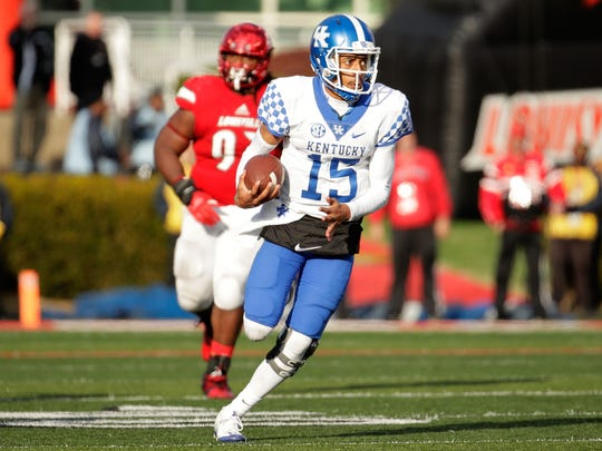 LOUISVILLE, KY - NOVEMBER 26:  Stephen Johnson #15 of the Kentucky Wildcats runs with the ball during the game against the Louisville Cardinals at Papa John's Cardinal Stadium on November 26, 2016 in Louisville, Kentucky.  (Photo by Andy Lyons/Getty Images)
