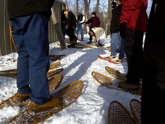 Try a snowshoe hike at Bay Beach Wildlife Sanctuary.