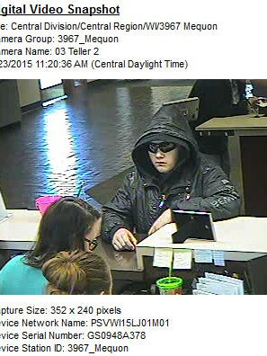 "A suspect in a Mequon bank robbery is described as white, between 5-5 and 5-7, soft spoken with a high-pitched voice and last seen wearing a black hooded jacket with ""RocaWear"" on the left sleeve, black hat and black sunglasses and jeans."
