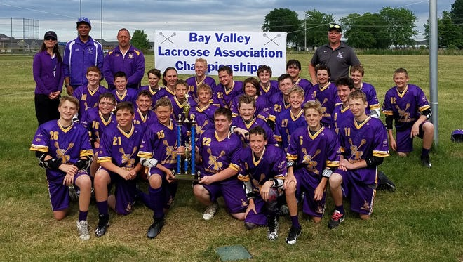 Stevens Point Youth Lacrosse 14U Team placed first at the Bay Valley Lacrosse Association Championship Games June 2.  Pictured, bottom row from left: Zack Adamski, Peyton Donahoe, Caleb Cuff, Luke Gorski, Shane Simon, Tanner Fjeldsted, Liam McGuire; second row, from left: Haiden Conrad, Jaxon Dickert, Braeden Austreng, Orion Voss, Max Gulan, Judah Huffman, Aidan George; third row, from left: Tyson Krueger, Trevor Vilbaum, Logan Mendyke, Simon Bienvenue, Eric Boettcher, Nathan Bellin, Garrett Shurpit, Blue Lawrence, Riley Downs, Evan Milkowski, Trevor Herman, Joshua Massey, Isaac Johnson; and back row, from left: Manager: Amy Simon, Head Coach: Clayton Bentz, Assistant Coaches: Dan Cuff and Neil Simon.