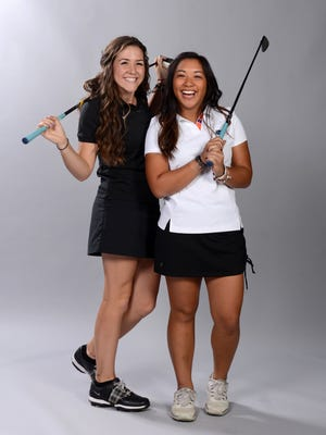 Miranda Holt (left) and Madison Pacheco, shown during their 2014 PNJ All-Area Team portrait, are joining Samantha Holt and Joanna Holt on Thursday to host a free girls golf clinic at Perdido Bay Golf Club. Holt is now a junior on the Southern Miss women's team; Pacheco is playing for the Florida Gators.
