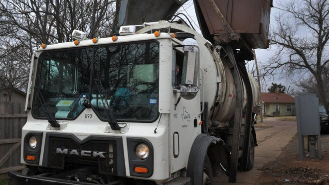 In this file photo, a Wichita Falls sanitation truck empties a Dumpster near Monroe Street. The city's trash pickup schedule will change for the Christmas and New Year's holidays.