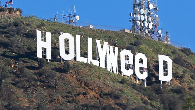 """The Hollywood sign is seen vandalized Sunday, Jan. 1, 2017. Los Angeles residents awoke New Year's Day to find a prankster had altered the famed Hollywood sign to read """"HOLLYWeeD."""""""