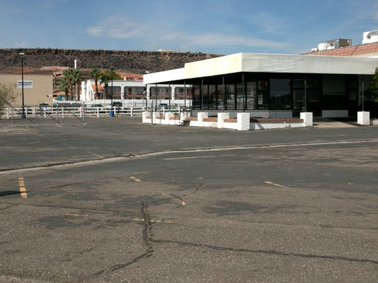 """In June of 1989, the original location of the Stephen Wade Cadillac, Chevrolet, Nissan and Mazda auto  dealerships was on the east side of Main Street just north of Interstate 15, as can be seen in the then image captured by Spectrum photographer Nancy Rhodes. In 2007, Stephen Wade's Cadillac and Chevy dealerships followed the Mazda and Nissan dealerships over to Hilton Drive leaving the building seen in the photo unoccupied. An RV dealership called the building home for a short time but for the past four and a half years, Rent & Repair has called the building home.  Rent & Repair in an auto mechanic shop that originally rented repair bays to car enthusiasts but ceased renting bays due to insurance issues and now just does car repairs. """"We do late model car repairs and classic car repairs and we are in the process of getting our used car dealers license,"""" said Victoria Jensen who, along with her husband Nick, owns Rent & Repair. Once the business owners have their dealers license, they plan to reopen the old Stephen Wade showroom and sell used cars from the lot. In addition to the changes that have taken place at the dealership, there are a few interesting differences that can be seen in the now image, taken by Spectrum photographer Jud Burkett. The Hardee's restaurant in the then image is now a Burger King, a hotel and the Standard Plumbing Supply buildings now stand on what was an empty lot in 1989, and between the buildings, you can just see the office building that was built a few years ago up on Blackridge Drive."""