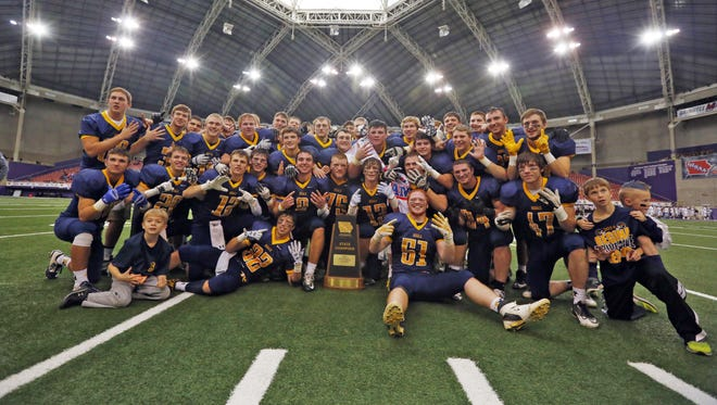 Iowa City Regina celebrates after winning the Class 1A Championship game with Western Christian Hull Monday, Nov. 23, 2015.