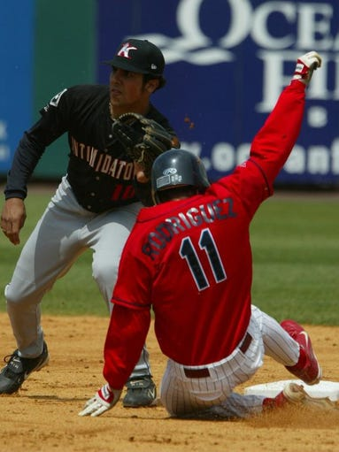 BlueClaws' Carlos Rodriguez is tagged out by Kannapolis Intimidators's Robert Valido during the 3rd inning at First Energy Park Sunday May 2.
