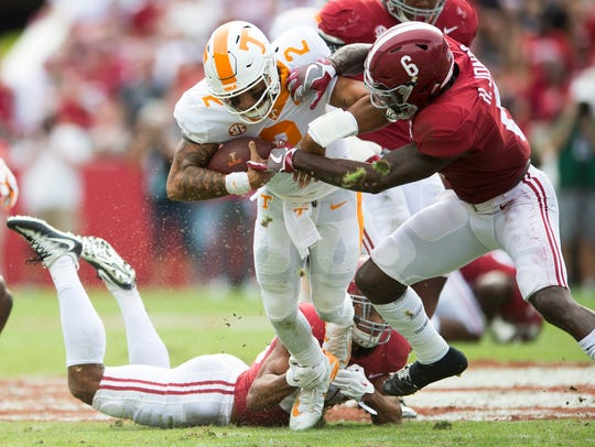 Tennessee quarterback Jarrett Guarantano (2) is tackled