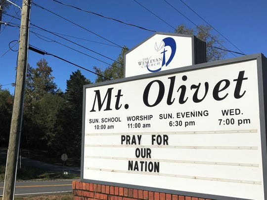 Mt. Olivet, a Wesleyan church near Central that closed more than a year ago, includes its denomination on the top part of the sign.