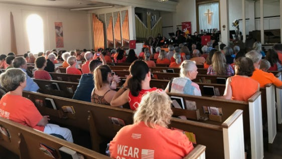 Dozens wore orange at the gathering at Phoenix First Congregational United Church of Christ in downtown Phoenix on Saturday, June 3.
