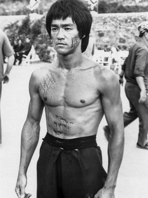 Bruce Lee is shown in a scene from the 1973 film 'Enter the Dragon'.