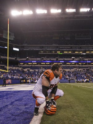 Bengals Tackle Eric Winston sits alone on the field after the Colts beat the Bengals at Lucas Oil Stadium in Indianapolis during the 2015 AFC Division Playoff between the Cincinnati Bengals and Indianapolis Colts.