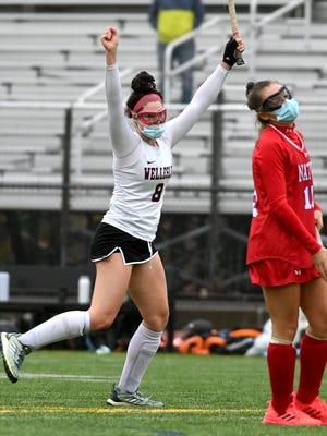 Wellesley's Grace Donahue celebrates after scoring a goal in the third quarter of Wednesday's game against Natick at Wellesley High School.