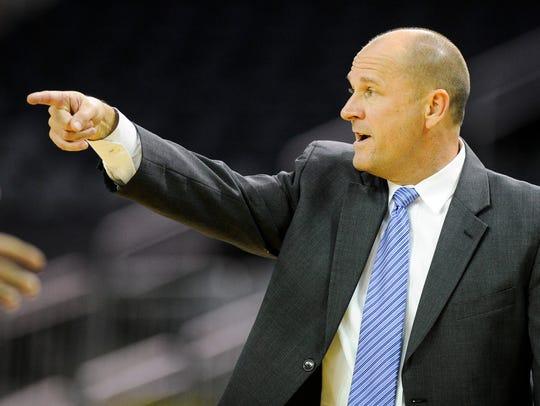 Alabama Huntsville head coach Lennie Acuff motions